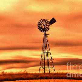 Windmill on the plains by Jeff Swan