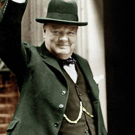 Winston Churchill, English Prime Minister, making the victory gesture in front of 10 Downing Street  - English School