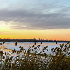 Winter Sunset By The River And City Skyline by Cristina Stefan