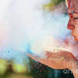Woman Blowing Colorful Holi Powder by Michal Bednarek