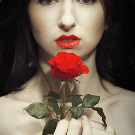 Amanda Elwell - Woman Holding A Red Rose