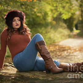 Woman Sitting On A Log - Amanda Elwell
