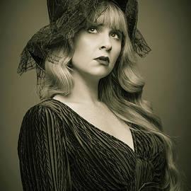Woman Wearing Witches Hat - Amanda Elwell