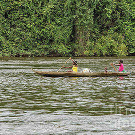 Women and child in canoe by Patricia Hofmeester