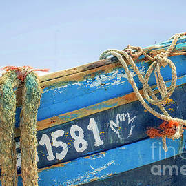 Wooden fishing boat by Patricia Hofmeester