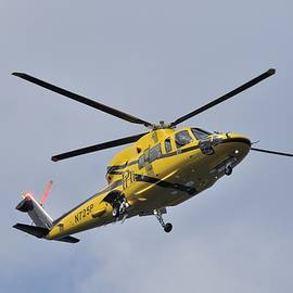 Yellow Commuter Helicopter in Flight