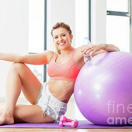 Michal Bednarek - Young woman relaxing after workout.