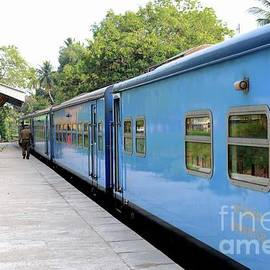 Blue Sri Lanka Colombo to Jaffna railway train parked at platform  by Imran Ahmed