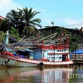 Fishing boats docked at fish harbor Pattani Thailand by Imran Ahmed