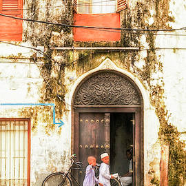 Kids walking in StoneTown Zanzibar 3620 by Neptune - Amyn Nasser Photographer