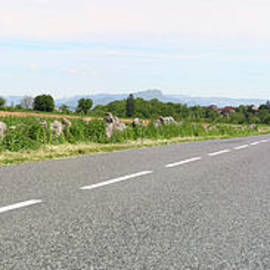 Panoramic of road to a village by Gregory DUBUS