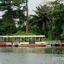 Pier with tourist boats for River Safari Cruise Singapore by Imran Ahmed
