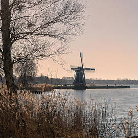 Windmill on a lake in the Netherlands