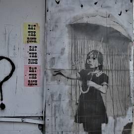Banksy Umbrella Girl In New Orleans Graffiti Speaks Louder Than Words by Michael Hoard