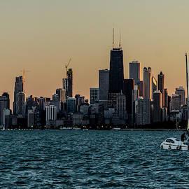 Sven Brogren - A Catamaran at sunset in front of the Chicago Skyline