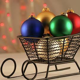A Christmas Sleigh of Ball Ornaments by Derrick Neill