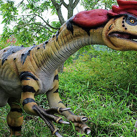 A Crested Dilophosaurus Dinosaur, Chester Zoo, England by Derrick Neill