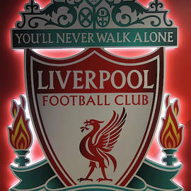 A Logo Placard at Anfield Football Stadium, Liverpool, Merseysid by Derrick Neill