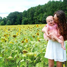 The Joys of Motherhood by Marilyn DeBlock