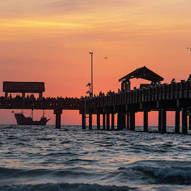 A Pirate Ship Sales Past The Clearwater Pier At Sunset Florida by Toby McGuire