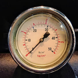 a round vintage industrial shiny pressure gauge with numbers marked in psi and metr by Philip Openshaw