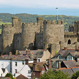 A View of Conwy Castle Rising Above the Rooftops of Conwy, Wales by Derrick Neill
