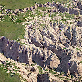 Aerial View Of Badlands National Park by Joan Carroll