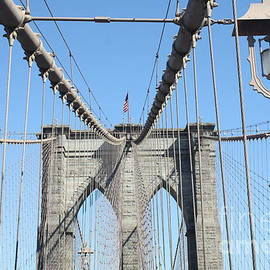 Old Fashioned St Light And Us Flag On The Brooklyn Bridge by John Telfer