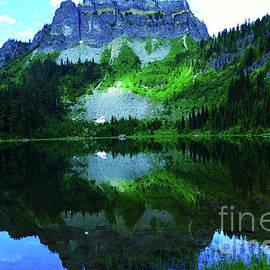 American Ridge reflecting into Cougar lake by Jeff Swan