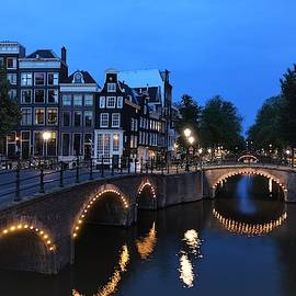 Amsterdam Canals lit up at night by Patricia Caron