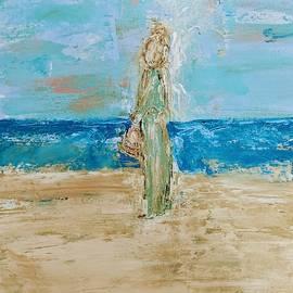 Angel on the beach by Jennifer Nease