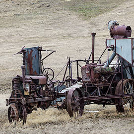 Antique Tractor And Bailer by Michael Chatt