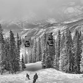 Aspen Skiers Under The Gondola Black And White by Adam Jewell