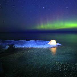Aurora Borealis at Lake Superior shore by Alex Nikitsin