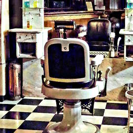 Barber Chair And Bottles Of Hair Tonic by Susan Savad
