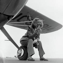 Bette Davis With Airplane, 1947 by Loomis Dean