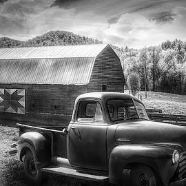 Black and White Truck at the Farm Barn by Debra and Dave Vanderlaan