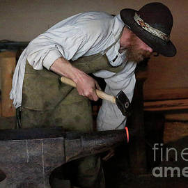 Blacksmith At Work by Jon Burch Photography