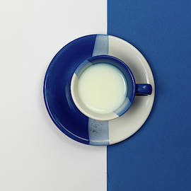 Blue and White coffee mug with fresh milk by Michalakis Ppalis