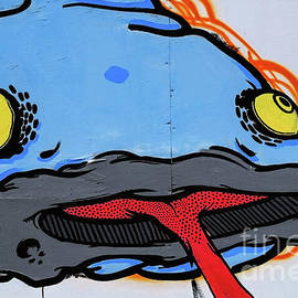 Blue catfish with yellow eyes and red tongue street art in Trieste, Friuli-Venezia Giulia, Italy by Terence Kerr