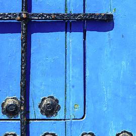 Blue wooden door  by Digby Merry