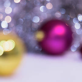 Blurry Christmas Background With Christmas Balls And Bokeh by Cristina Stefan