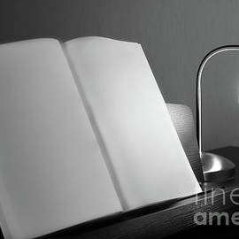 Book resting on piano by Gregory DUBUS