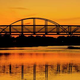 Bridge in Sun Set by Brigitta Diaz