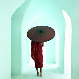 Buddhist Monk Walking Along Arched by Martin Puddy
