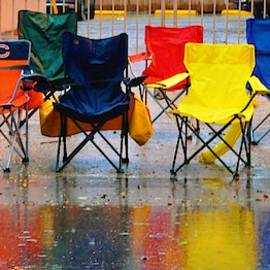 Chairs Spectrum Rain And Mardi Gras In New Orleans by Michael Hoard