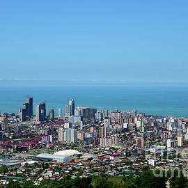 Cityscape skyline with high rise building towers Black Sea horizon Batumi Georgia by Imran Ahmed