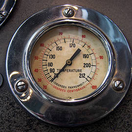 close up of an old round metal industrial temperature gauge by Philip Openshaw
