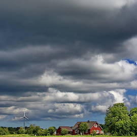 Clouds over the house by Ren Kuljovska