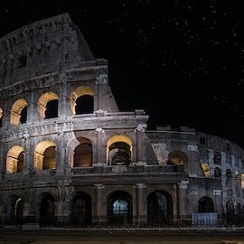 Coliseum At Night by Jaroslaw Blaminsky